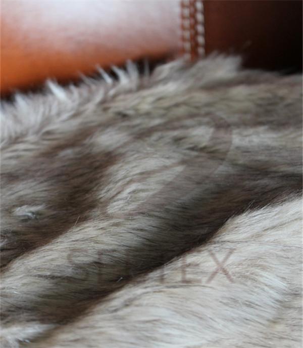 Gray wolf faux fur pillow